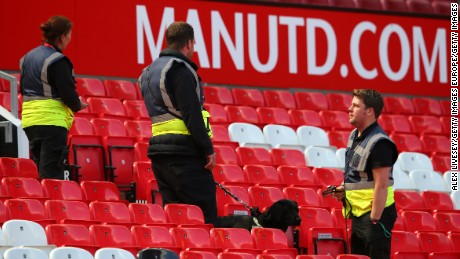 A sniffer dog patrols the stands prior to the match being abandoned with fans evacuated from the ground prior to the Barclays Premier League match between Manchester United and AFC Bournemouth at Old Trafford.
