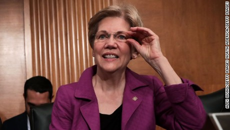 """WASHINGTON, DC - APRIL 07:  U.S. Sen. Elizabeth Warren (D-MA) waits for the beginning of a hearing before the Senate Banking, Housing and Urban Affairs Committee April 7, 2016 on Capitol Hill in Washington, DC. The committee held a hearing on """"The Consumer Financial Protection Bureau's Semi-Annual Report to Congress.""""  (Photo by Alex Wong/Getty Images)"""