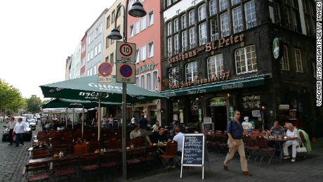 COLOGNE, GERMANY - SEPTEMBER 07:  People are seen siting in the garden pub on the Heumarkt Square in the Old Town on September 07, 2005 in Cologne, Germany. Cologne is one of the host cities that will be used to stage the FIFA World Cup Germany 2006.  (Photo by Vladimir Rys/Bongarts/Getty Images)