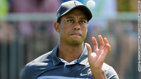 GREENSBORO, NC - AUGUST 21:  Tiger Woods catches the golf ball thrown from his caddie on the 15th green during the second round of the Wyndham Championship at Sedgefield Country Club on August 21, 2015 in Greensboro, North Carolina.  (Photo by Jared C. Tilton/Getty Images)