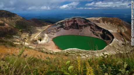 "Okama crater lake, Mt. Zao. Three mountains of the complex Zao mountain range surrounds this circular crater lake named after ""kama,"" the Japanese word for an iron pot that shares its shape. It sits on the border between Yamagata and Miyagi prefectures."