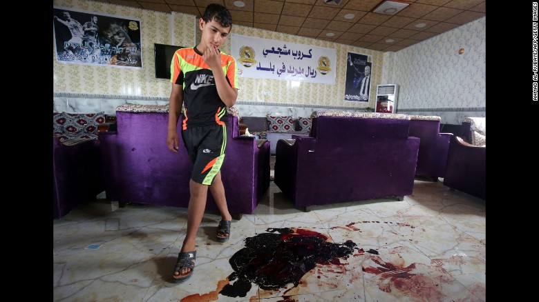 "A boy walks past bloodstains and debris at a cafe in Balad, Iraq, that was attacked by ISIS gunmen on Friday, May 13. Twenty people were killed. <a href=""http://www.cnn.com/2016/05/17/middleeast/iraq-violence/"" target=""_blank"">ISIS attacks in Iraq</a> have claimed more than 100 lives in the past week."
