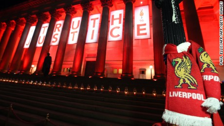 "Flowers are laid and candles are lit on the steps of St Georges Hall in Liverpool,north west England on April 26, 2016, in remembrance of the 96 Liverpool fans who died in the Hillsborough football stadium disaster. The fans who died were unlawfully killed, a jury has concluded, finding Britain's worst sporting tragedy was partly down to police errors. The result, which concluded a near three-decade campaign by relatives of the victims of the 1989 match, was splashed across the front pages of Wednesday's newspapers. ""After 27 years, justice"" read The Guardian. / AFP / PAUL ELLIS        (Photo credit should read PAUL ELLIS/AFP/Getty Images)"