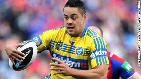 NEWCASTLE, AUSTRALIA - AUGUST 30:  Jarryd Hayne of the Eels evades Beau Scott of the Knights during the round 25 NRL match between the Newcastle Knights and the Parramatta Eels at Hunter Stadium on August 30, 2014 in Newcastle, Australia.  (Photo by Ashley Feder/Getty Images)