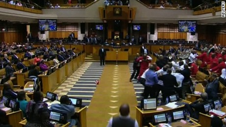 Members of the leftist opposition party were removed from South Africa's parliament after they tried to stop President Zuma from giving a speech.