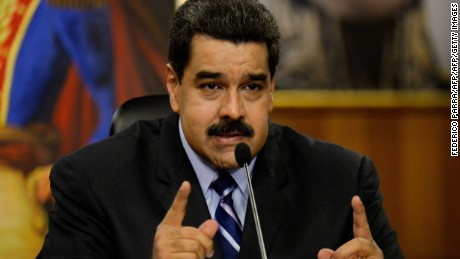 """Venezuelan President Nicolas Maduro speaks during a press conference at the Miraflores presidential palace in Caracas on May 17, 2016. The army in crisis-hit Venezuela has to choose whether it is """"with the constitution or with (President Nicolas) Maduro,"""" opposition leader Henrique Capriles said Tuesday. / AFP / FEDERICO PARRA        (Photo credit should read FEDERICO PARRA/AFP/Getty Images)"""
