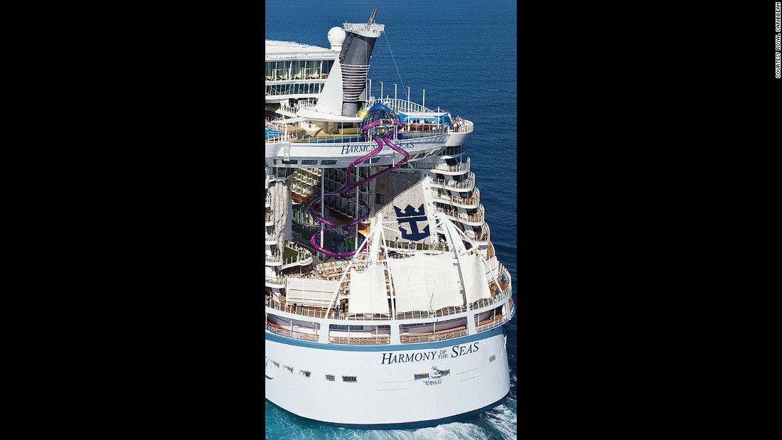 """See those purple, squiggly things in the back of the ship? That's one of Harmony's biggest attractions: The Ultimate Abyss, which the cruise line calls """"the tallest slide on the high seas."""" It takes guests on a 100-foot drop from Deck 16 to Deck 6."""