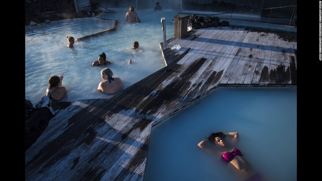 A woman floats in the Blue Lagoon, a geothermal spa and one of Iceland's most popular attractions. The water's temperature averages 37-39 degrees Celsius (98.6-102.2 Fahrenheit).