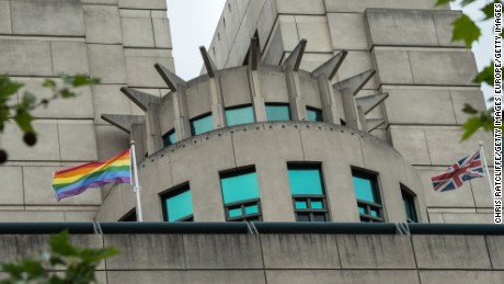 LONDON, ENGLAND - MAY 17:  A rainbow flag flies alongside a Union Jack outside the MI6 building in support of International Day Against Homophobia on May 17, 2016 in London, England. The rainbow flag is commonly associated with gay rights and the International Day Against Homophobia started in 2004, with people across the globe celebrating gay rights. The MI6 building at Vauxhall is the headquaters of the British Secret Intelligence Service (SIS).  (Photo by Chris Ratcliffe/Getty Images)