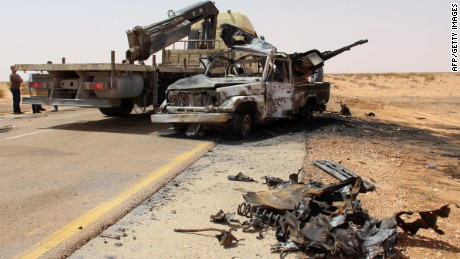 A truck removes the wreckage following a bomb attack near Misrata in April.