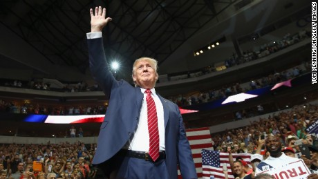 Republican presidential candidate Donald Trump waves to the audience gathered for a campaign rally at the American Airlines Center on September 14, 2015 in Dallas, Texas. More than 20,000 tickets have been distributed for the event.