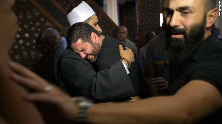 Samir Abdel Bary, the Imam of al Thawrah Mosque in Cairo, Egypt, gives condolences to film director Osman Abu Laban who lost four relatives on the crashed EgyptAir MS804 on Friday, May 20.