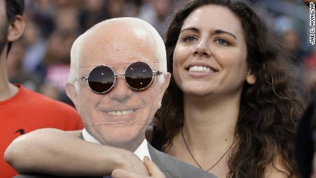 Kaitlin Cordova, center, holds a cardboard cutout of Democratic presidential candidate Sen. Bernie Sanders, I-Vt., during a rally on Tuesday, May 17, 2016, in Carson, Calif. (AP Photo/Jae C. Hong)