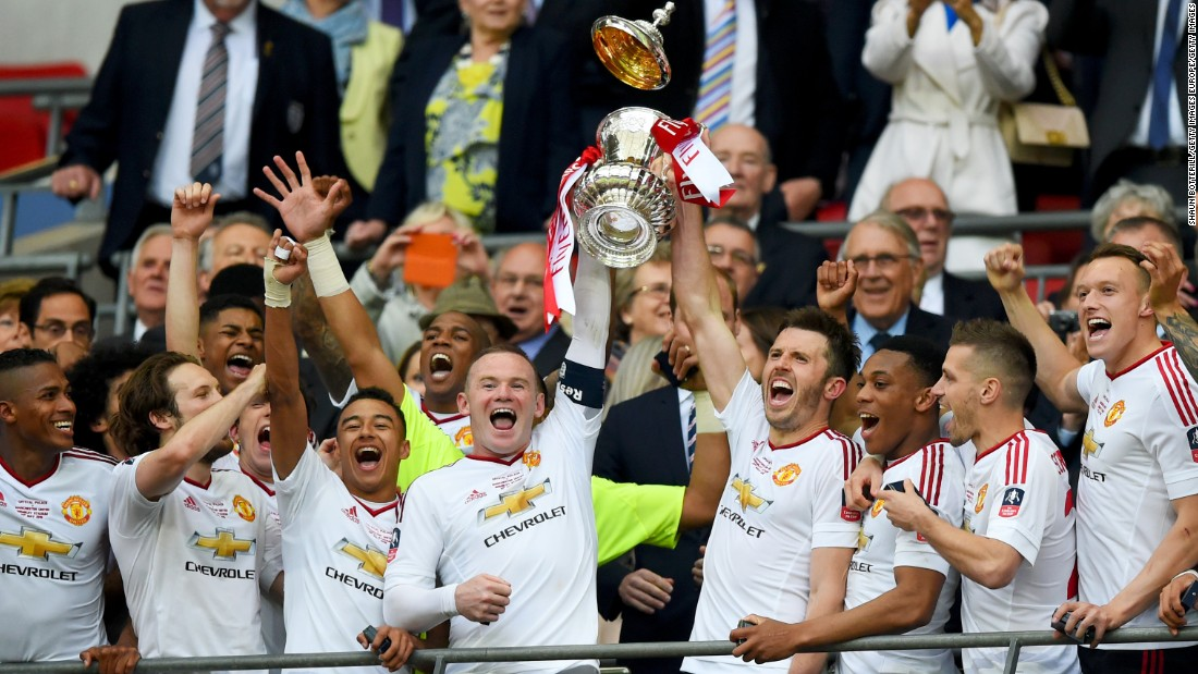United's players celebrate winning the 2016 FA Cup after beating Crystal Palace 2-1 in the final. It was the club's first triumph in the competition since 2004.
