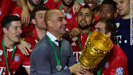 Bayern Munich manager Pep Guardiola celebrates after winning the DFB Pokal final.