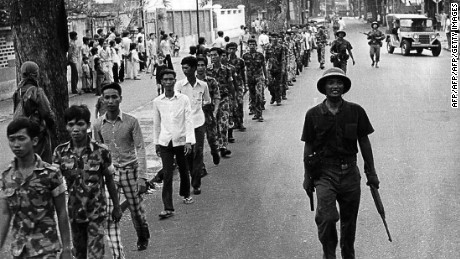 (VIETNAM-25, 2/3)  A 30 April 1975 photo shows a line of captured US-backed South Vietnamese Army soldiers, escorted by Vietnamese communist soldiers, as they walk on a Saigon street after the city fell into the hands of the communist troops on the same day, marking the end of the Vietnam War. Government calls for a renewed spirit of self-sacrifice 25 years after the end of the Vietnam War are met with increasingly deaf ears from a post-war generation which eyes the material prosperity of Vietnam's pro-Western neighbours with envy. AFP PHOTO        (Photo credit should read AFP/AFP/Getty Images)