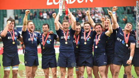 Scotland's players celebrate with the trophy after winning the final of the World Rugby Sevens Series - London, rugby union tournament between Scotland and South Africa, at Twickenham in south west London on May 22, 2016. Scotland beat South Africa 27-26. / AFP / OLLY GREENWOOD        (Photo credit should read OLLY GREENWOOD/AFP/Getty Images)