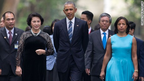 President Barack Obama, center, walks with chairwoman of the National Assembly Nguyen Thi Kim Ngan, center left, at the Presidential Palace compound in Hanoi, Vietnam, on Monday, May 23.
