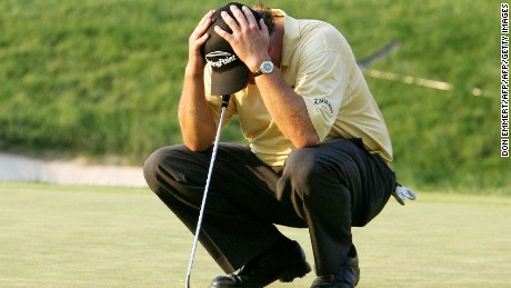 Mamaroneck, UNITED STATES:  Phil Mickelson of the US holds his head while waiting for Kenneth Ferrie to putt on the 18th green during the final round of the 2006 US Open Championships 18 June 2006 at Winged Foot Golf Club in Mamaroneck, NY. Mickelson lost the tournament to Australian Geoff Ogilvy on the 18th hole.     AFP PHOTO/Don EMMERT  (Photo credit should read DON EMMERT/AFP/Getty Images)