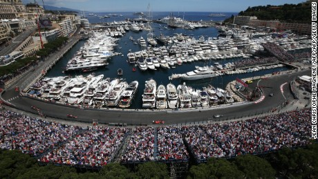 Spectators in terraces watch drivers racing along Monaco's harbour  at the Monaco street circuit in Monte-Carlo on May 24, 2015, during the Monaco Formula One Grand Prix. AFP PHOTO / JEAN CHRISTOPHE MAGNENET        (Photo credit should read JEAN CHRISTOPHE MAGNENET/AFP/Getty Images)