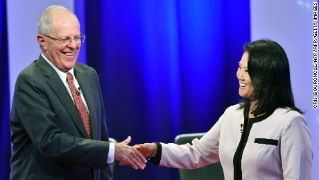 "Peruvian presidential candidates Pedro Pablo Kuczynski of ""Peruanos por el Kambio"" and Keiko Fujimori of Fuerza Popular shake hands after a televised nation-wide debate in the northern city of Piura, 970 kilometers north of Lima, on May 22, 2016.  The two candidates, who both offer a centrist political platform and are direct descendants of immigrants in a country with a large indigenous population, will compete in the June 5 runoff election. / AFP / CRIS BOURONCLE        (Photo credit should read CRIS BOURONCLE/AFP/Getty Images)"