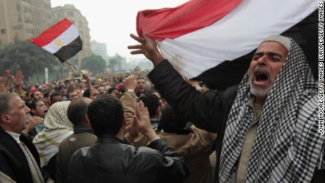 CAIRO, EGYPT - FEBRUARY 07:  Anti-government demonstrators chant for freedom in Tahrir Square on February 7, 2011 in Cairo, Egypt. Almost two weeks since the uprising began, thousands of protesters continue to occupy the square, demanding the resignation of President Hosni Mubarak.  (Photo by John Moore/Getty Images)