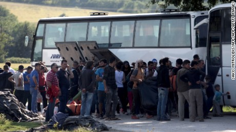 People board in a bus in order to leave the refugee and migrant makeshift camp on the Greek-Macedonia border near the village of Idomeni on May, 23 2016. Greece said on May 23 it will step up efforts to clear the squalid camp of Idomeni where over 8,400 migrants remain on the border with Macedonia after braving a winter in vain hope of being allowed through to Europe. / AFP / SAKIS MITROLIDIS        (Photo credit should read SAKIS MITROLIDIS/AFP/Getty Images)