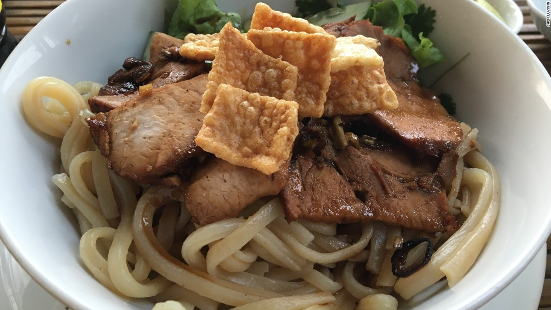This pork noodle dish from Hoi An is a bit like the various cultures that visited the trading port at its prime. The thicker noodles are similar to Japanese udon, the crispy won-ton crackers and pork are a Chinese touch, while the broth and herbs are clearly Vietnamese.