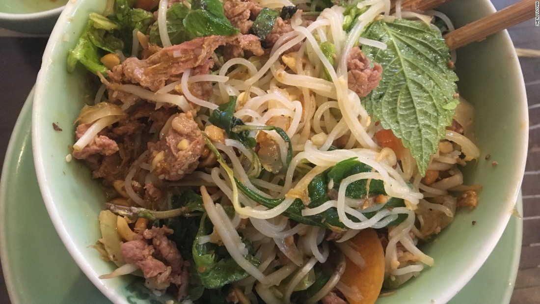 In this broth-free bowl of vermicelli noodles, tender slices of beef mingle with crunchy peanuts, bean sprouts, fresh herbs, crisp dried shallots, a splash of fish sauce and fiery chili pepper.