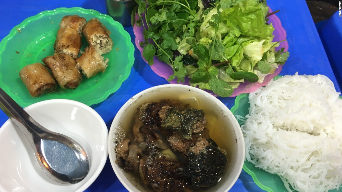 In this dish, small patties of seasoned pork and slices of marinated pork belly are grilled over a charcoal fire. The charred, crispy morsels are served with a large bowl of a fish sauce-heavy broth, a basket of herbs and a helping of rice noodles.