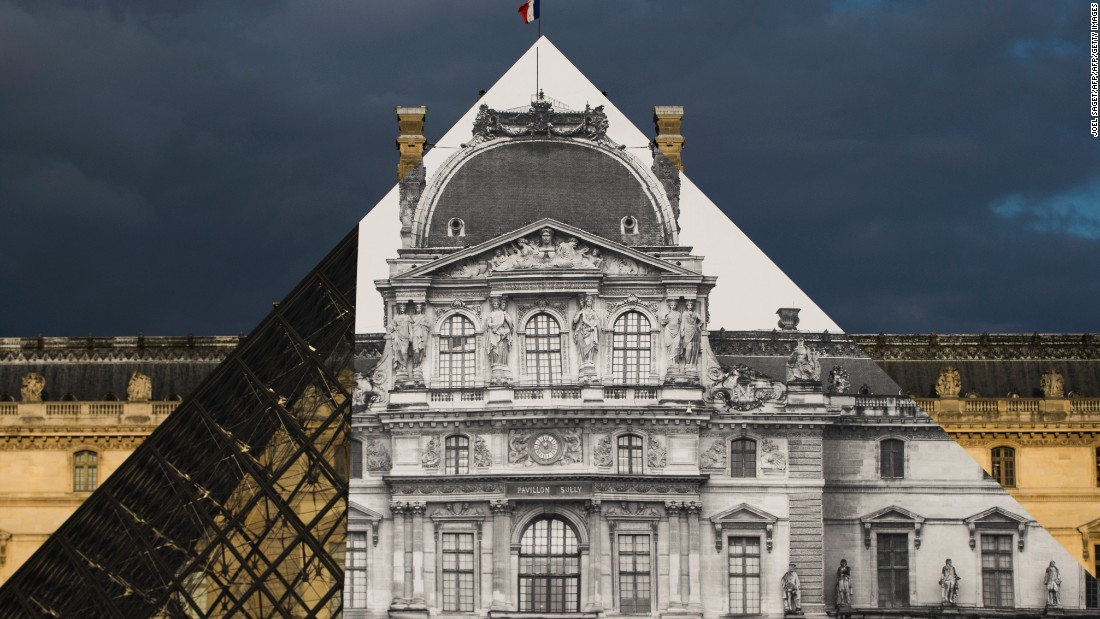 "Street artist JR created the <a href=""http://edition.cnn.com/2016/05/24/arts/jr-louvre/"">ultimate trompe l'oeil illusion</a> when he covered I.M. Pei's famous Pyramid with a black-and-white photograph in May 2016."