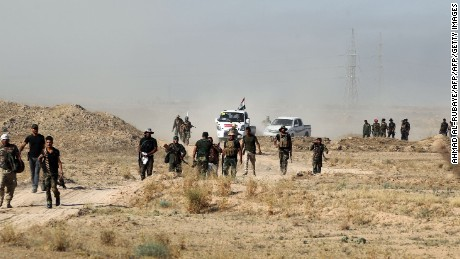 Iraqi pro-government forces advance on Falluja in a push to retake the city from ISIS.