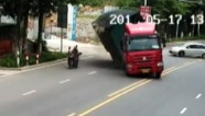 Motorcyclist cheats death in China