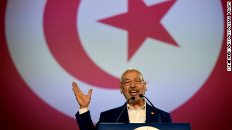 Tunisian Islamist Ennahdha Party leader Rached Ghannouchi gives a speech on May 20, 2016 at the opening of Ennahdha's three-day congress in Tunis. Thousands of people attend the opening ceremony of the congress on May 20, 2016, the first one since 2012, held at a sports complex in Rades, south of the capital Tunis, amid heavy police security.  / AFP / FETHI BELAID        (Photo credit should read FETHI BELAID/AFP/Getty Images)