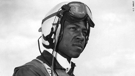 Navy aviator Jesse Brown standing on the deck of an aircraft carrier in North Korea. This photo of Brown, whose childhood hero was Olympic sprinter Jesse Owens, was taken for an Ebony magazine profile.