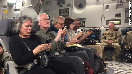 Journalists on the plane send one last email before the are wheels up.