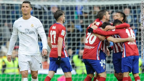 MADRID, SPAIN - FEBRUARY 27:  Cristiano Ronaldo of Real Madrid walks away from celebrating Atletico Madrid players after Atletico beat Real 1-0 in the La Liga match between Real Madrid CF and Club Atletico de Madrid at Estadio Santiago Bernabeu on February 27, 2016 in Madrid, Spain.  (Photo by Denis Doyle/Getty Images)