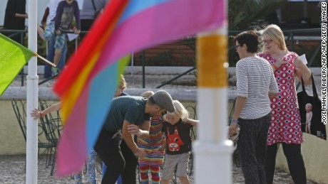 Parents and kids play during the 4th European Meeting of Rainbow Families for gay, bisexual and transgender persons in Oeiras on the outskirts of Lisbon on October 17, 2015..  AFP PHOTO / JOSE MANUEL RIBEIRO        (Photo credit should read JOSE MANUEL RIBEIRO/AFP/Getty Images)