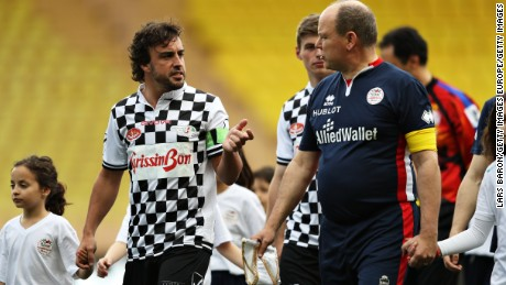 MONTE-CARLO, MONACO - MAY 24: Fernando Alonso of Spain and McLaren Honda talks to Prince Albert of Monaco ahead of the 24th World Stars football match at Stade Louis II, Monaco before the Monaco Formula One Grand Prix at Circuit de Monaco on May 24, 2016 in Monte-Carlo, Monaco.  (Photo by Lars Baron/Getty Images)