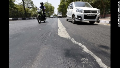 NEW DELHI, INDIA - MAY 19: A road melts as temperature rises to 43 degrees at Rau Tula Ram Marg as heat wave-like conditions prevailed across the city making life tough for the Delhiites, on May 19, 2016 in New Delhi, India. Heat waves hit north India only in the last two days and these conditions are likely to continue for this week. Several places in Madhya Pradesh, Rajasthan, Maharashtra, Uttar Pradesh and Bihar recorded temperatures above 45C on Thursday. In the capital city of Delhi, weather stations recorded temperatures between 43C and 45C, according to IMD data. (Photo by Sanjeev Verma/Hindustan Times ) *** Please Use Credit from Credit Field ***
