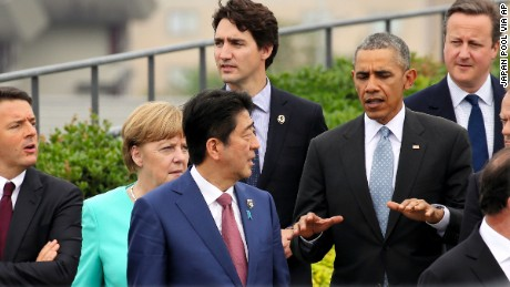 Japanese Prime Minister Shinzo Abe, center, chats with U.S. President Barack Obama, fifth left, as other leaders of Group of Seven industrial nations, from left, Italian Prime Minister Matteo Renzi, German Chancellor Angela Merkel, Abe, Canadian Prime Minister Justin Trudeau, top, Obama,  British Prime Minister David Cameron and European Council President Donald Tusk, walk along for a family photo session on the first day of the G-7 summit meetings in Shima, Japan, Thursday, May 26, 2016. (Japan Pool via AP) JAPAN OUT