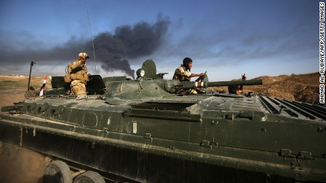 Iraqi pro-government forces advance towards the city of Falluja on Monday, May 23.