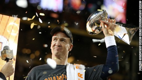 SANTA CLARA, CA - FEBRUARY 07:  Peyton Manning #18 of the Denver Broncos celebrates with the Vince Lombardi Trophy after Super Bowl 50 at Levi's Stadium on February 7, 2016 in Santa Clara, California. The Broncos defeated the Panthers 24-10.  (Photo by Patrick Smith/Getty Images)