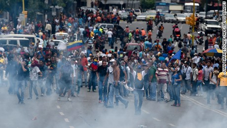 People protest against new emergency powers decreed this week by President Nicolas Maduro in Caracas on May 18, 2016. Public outrage was expected to spill onto the streets of Venezuela Wednesday, with planned nationwide protests marking a new low point in Maduro's unpopular rule. / AFP / JUAN BARRETO        (Photo credit should read JUAN BARRETO/AFP/Getty Images)