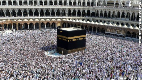 Muslim pilgrims perform the final walk around the Kaaba at the Grand Mosque in Mecca on November 30, 2009.