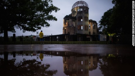 A man stands in front of the Peace Memorial Genbaku Dome in the Hiroshima Peace Memorial park in Naka Ward, Hiroshima Prefecture on May 25, 2016. US President Barack Obama is set to become the first sitting US president to visit Hiroshima when he journeys on May 27 with Japanese Prime Minister Shinzo Abe, hallowed ground to Japanese but, for more than 70 years, a no-go zone for 11 of his Oval Office predecessors.   / AFP / JOHANNES EISELE        (Photo credit should read JOHANNES EISELE/AFP/Getty Images)