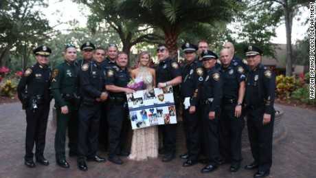 Pinellas, Pasco law enforcement officers escort daughter of fallen officer to prom.