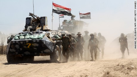 Iraqi government forces advance near al-Sejar village, north-east of Fallujah, on May 26, 2016, as they take part in a major assault to retake the city from the Islamic State (IS) group. Tens of thousands of security forces are deployed in the Fallujah area for an assault aimed at retaking the city from the Islamic State group. Fallujah, which lies only 50 kilometres (30 miles) west of Baghdad, has been out of government control since January 2014 and is one of only two remaining major Iraqi cities still in IS hands, the other being Mosul. / AFP / AHMAD AL-RUBAYE        (Photo credit should read AHMAD AL-RUBAYE/AFP/Getty Images)
