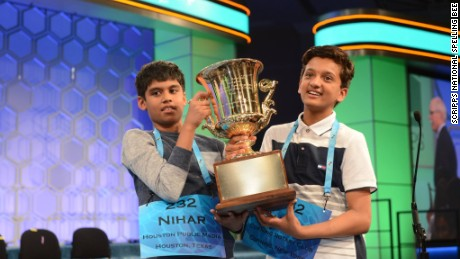 Co-champions Nihar Janga and Jairam Hathwar hold the 2016 National Spelling Bee trophy