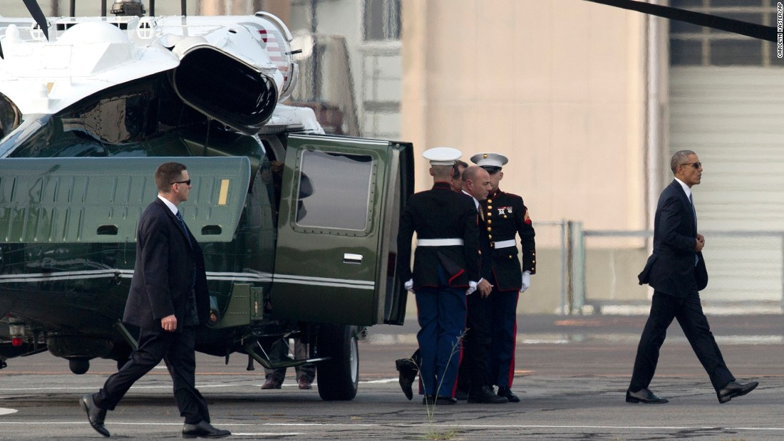 President Obama walks off Marine One at the landing zone in Hiroshima, western Japan.
